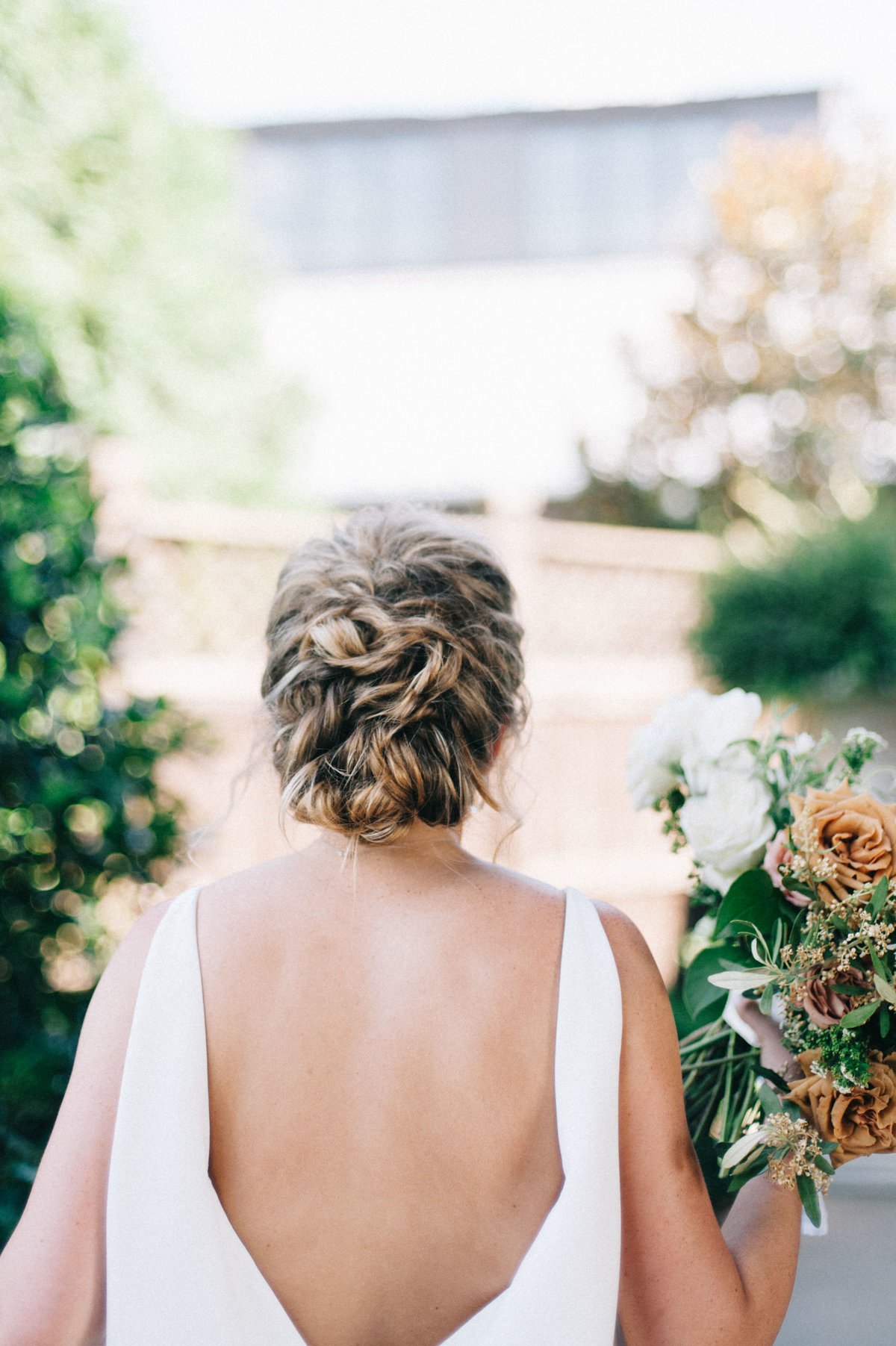 Stunning updo and open back wedding dress at a wedding in Birmingham, AL