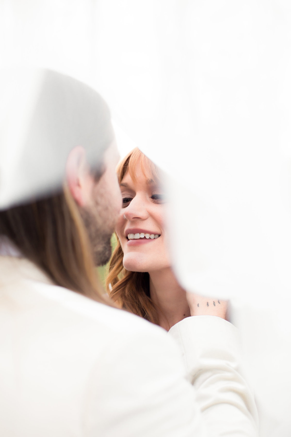 groom holding bride with veil for Atlanta photographer