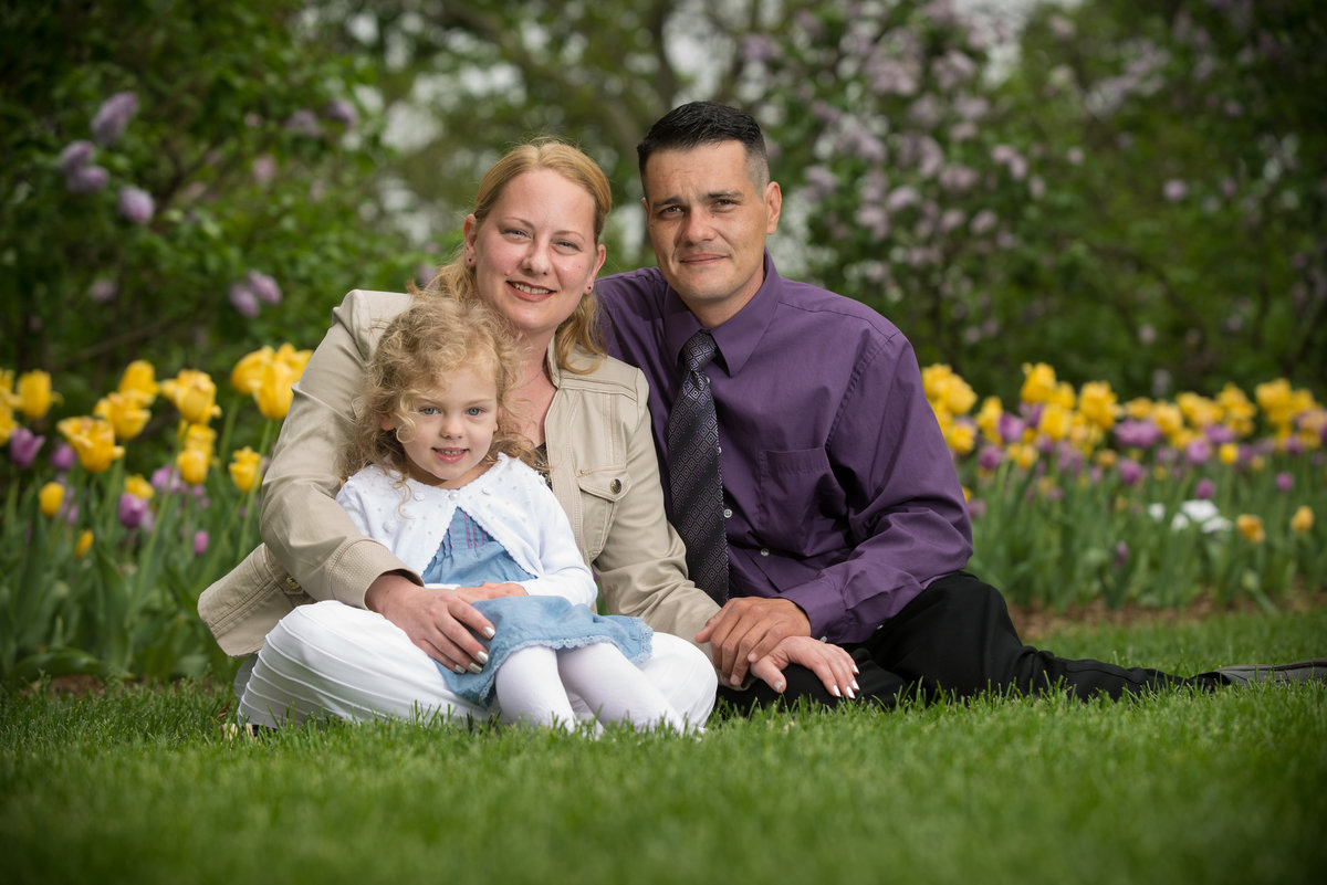 Family portrait with tulip background in Lilacia park in Lombard