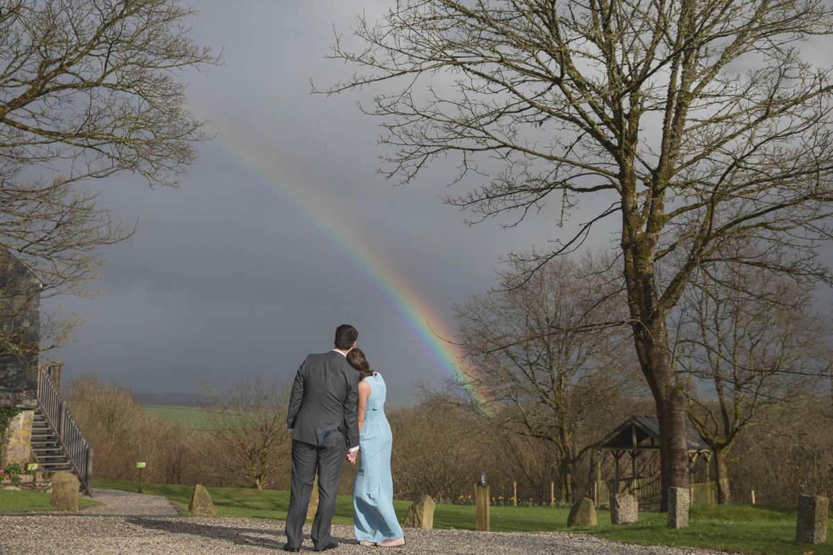 Rainbow over The Green with wedding couple elopement at The Green Cornwall