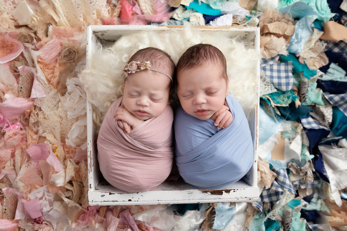 Twins curled up asleep