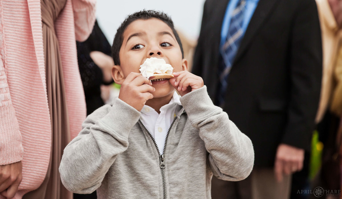 Funny Colorado Wedding Photography Boy Takes Huge Bite out of Dessert
