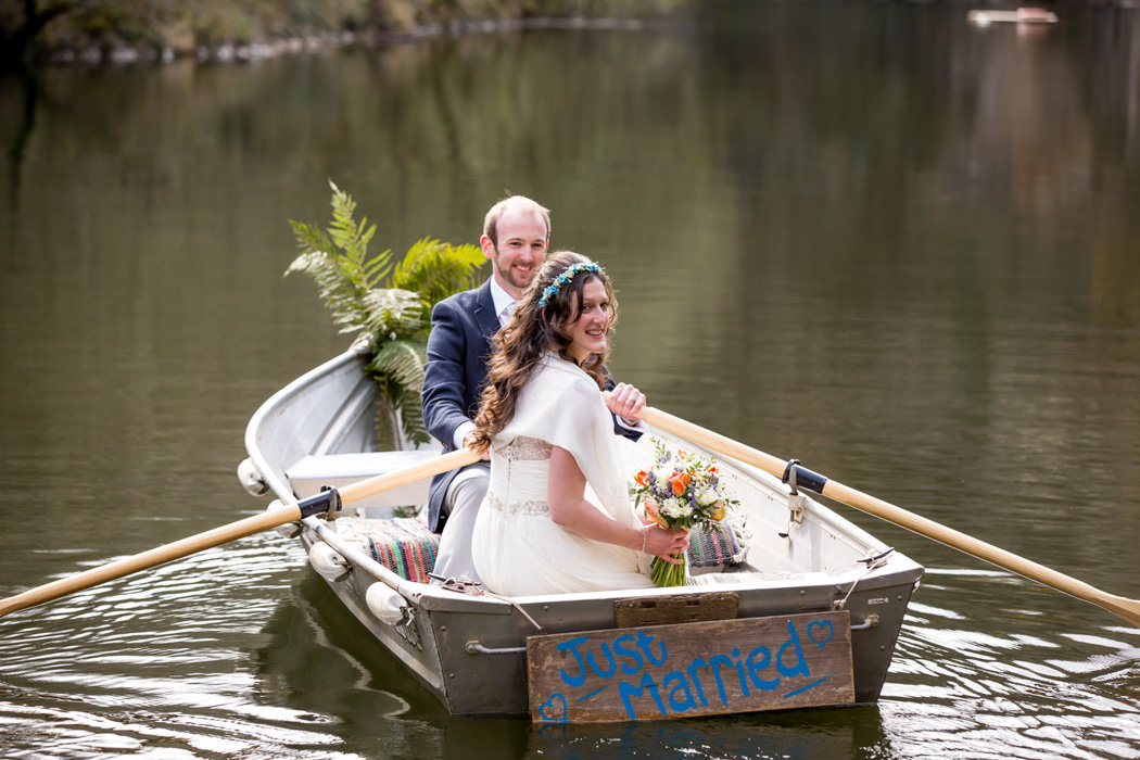 Bride and Groom in a boat at Cornish wedding