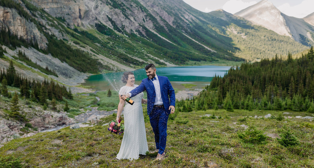 heli elopement lake of the falls mountain wedding champagne pop spray