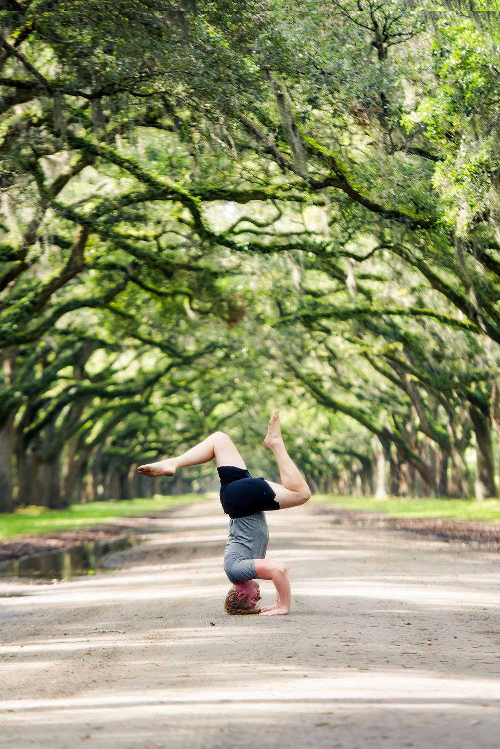 man tripod headstand georgia