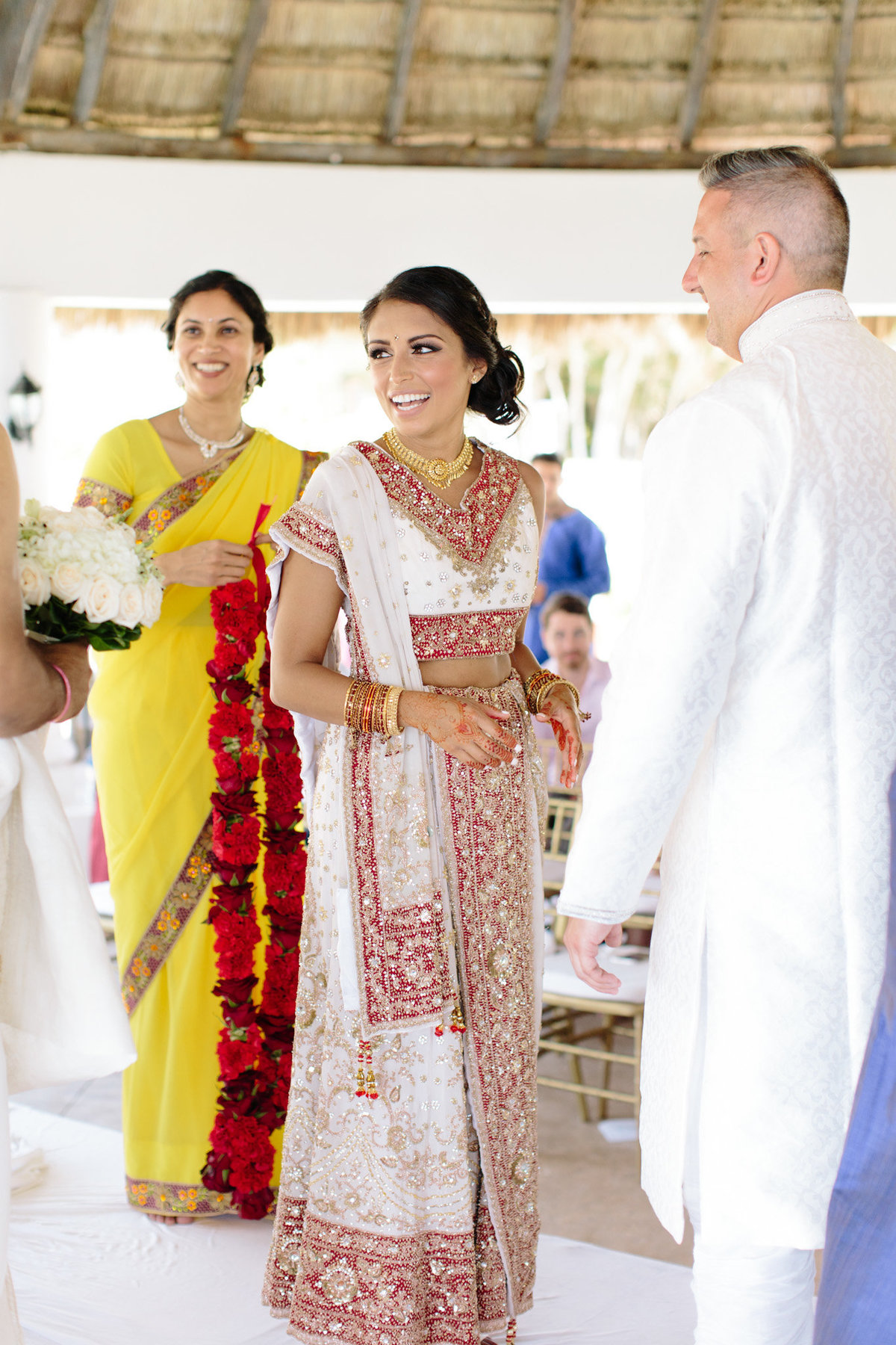A bride is glowing in her sari.  Emotion captured by top destination photographer Rebecca Cerasani.