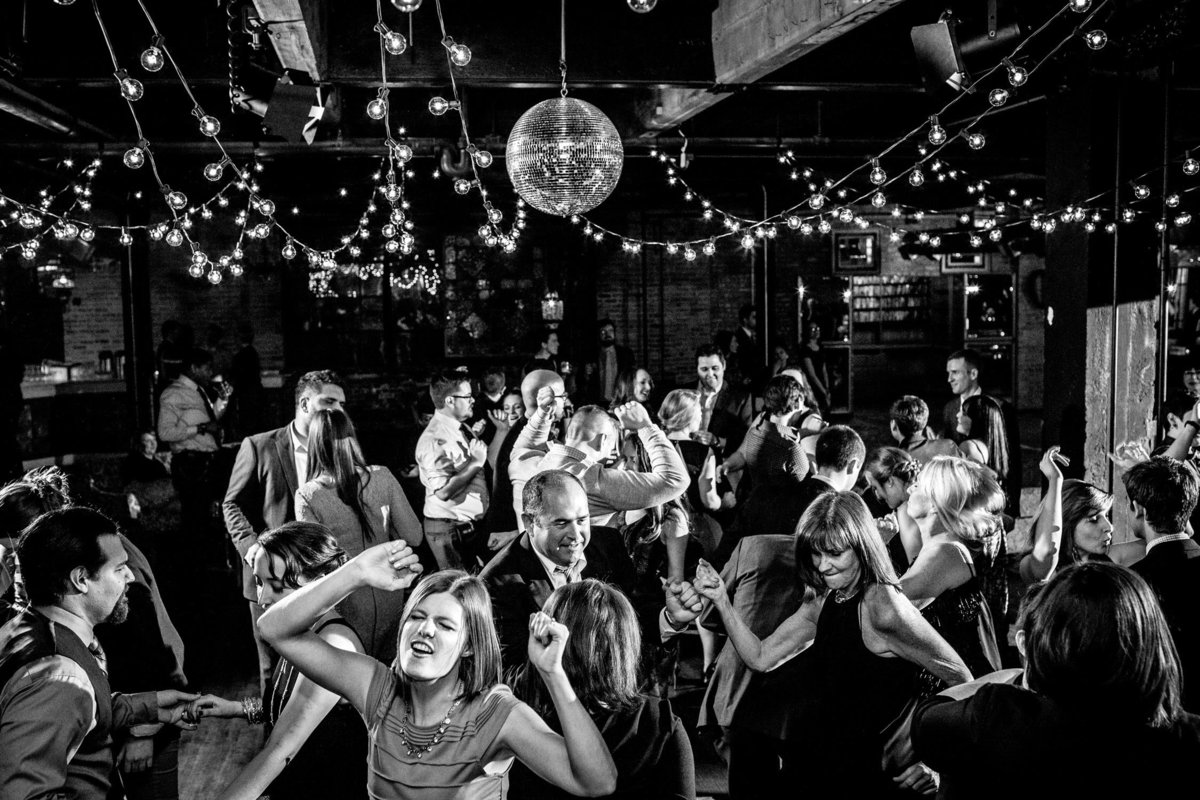 Guests dance together at a Salvage One wedding reception in Chicago.