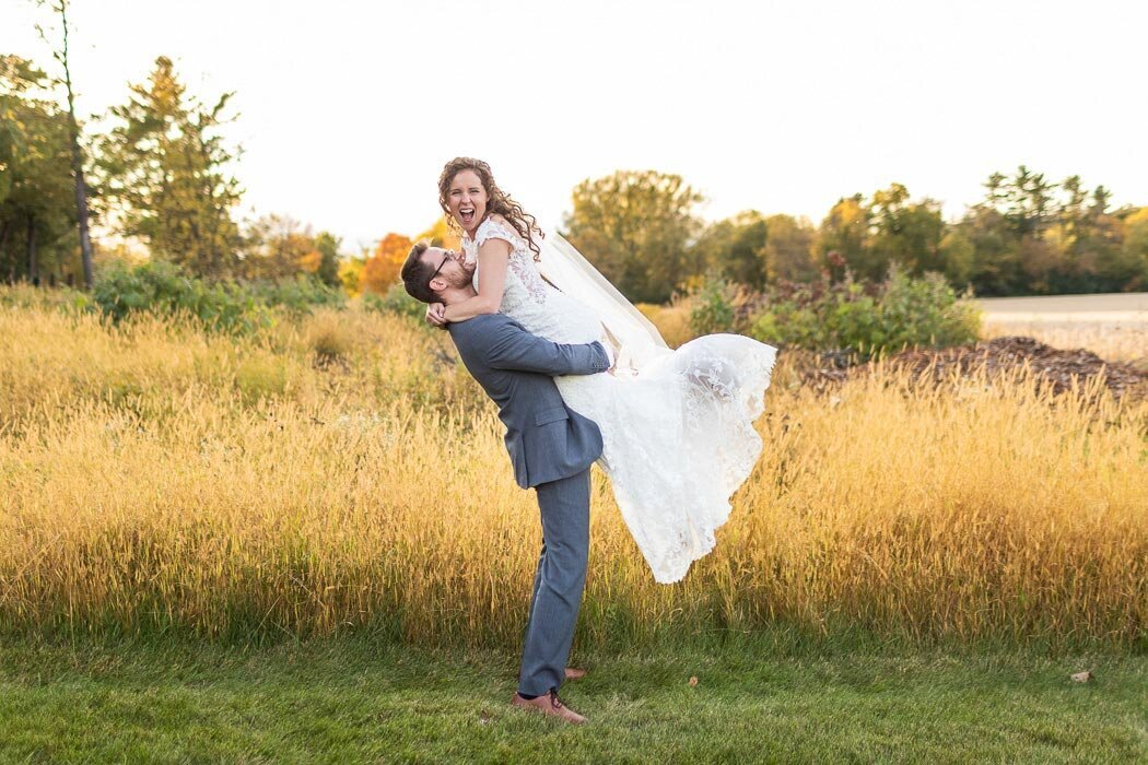 Mayowood Stone Barn wedding with an unbelievable golden hour is perfect for portraits of the bride and groom.