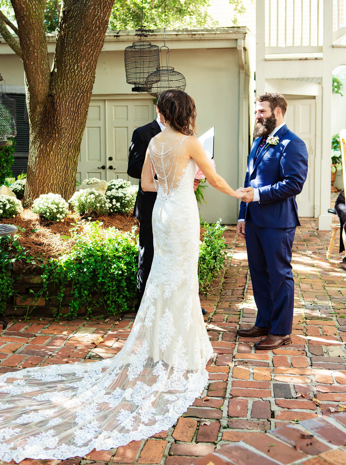 NOLA destination wedding couple saying their vows in the courtyard of The Terrell House