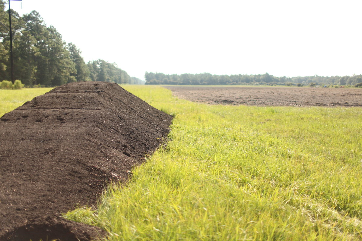 60 yards of Farmer D compost about to spread on the farm at Longleaf Preserve 2010