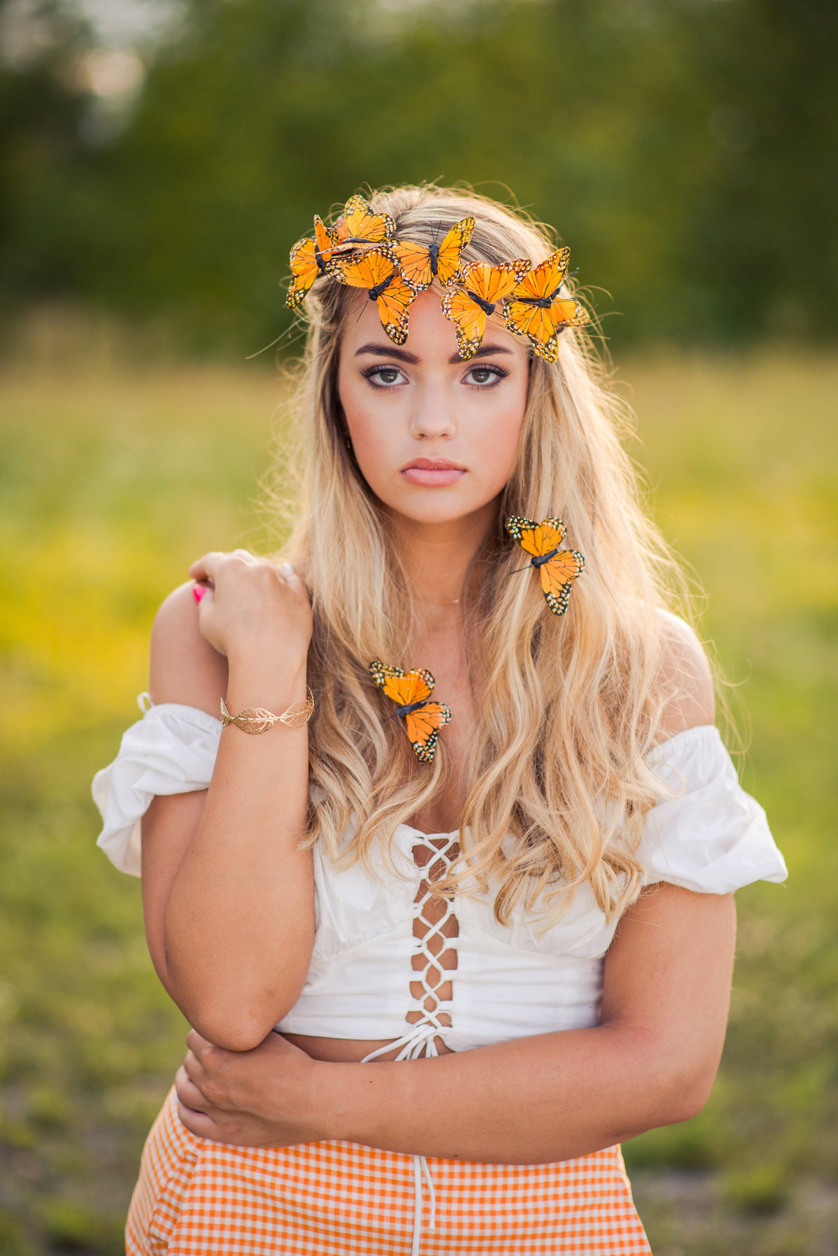 Senior Session Girl in Field with Butterflies