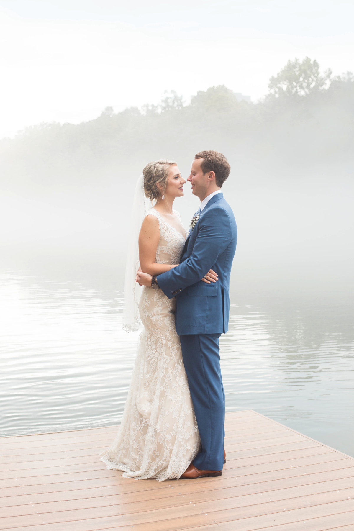 classy bride and groom on water while Atlanta wedding photographer takes a candid picture