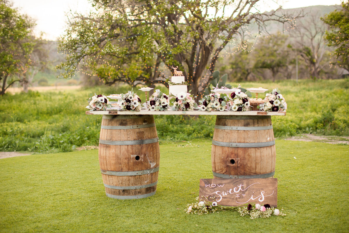 desert table cake flowers winery nature outdoor wedding colorado wedding romantic