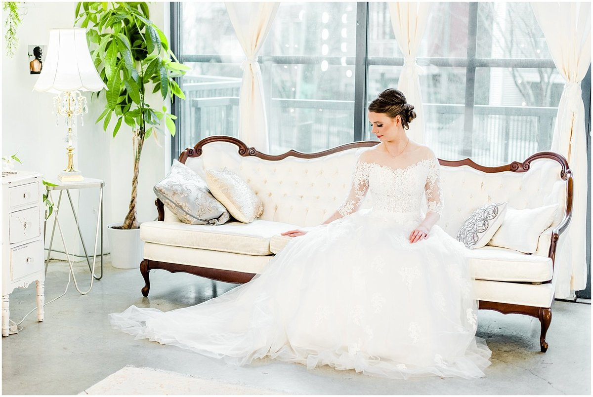 vancouver-wedding-salon-bride-in-dress-on-vintage-couch