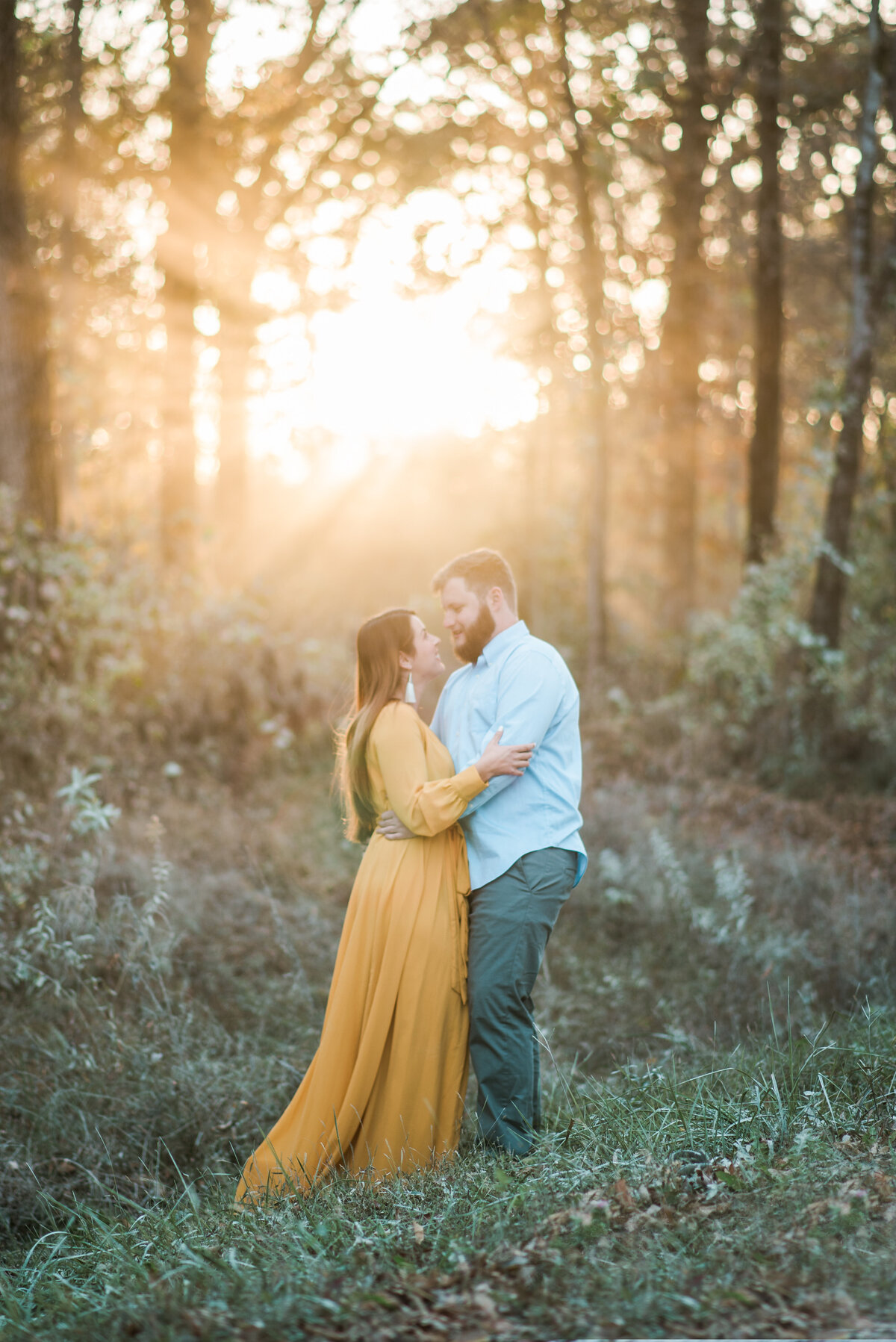 Couple at engagement session with beautiful smoky backlight