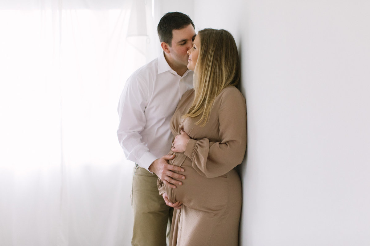 Two parents with their hands on pregnant belly