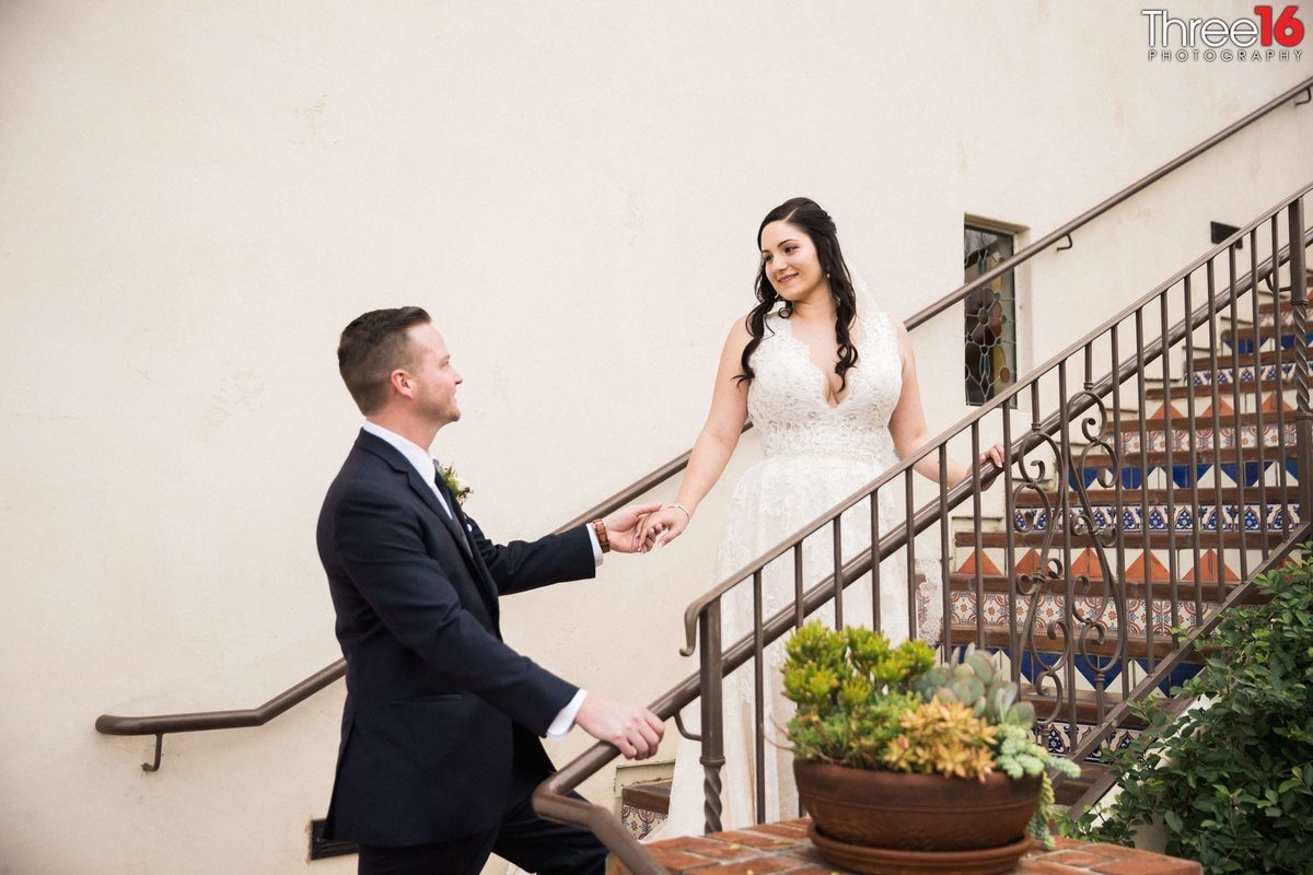 Groom addresses his Bride on the stairwell