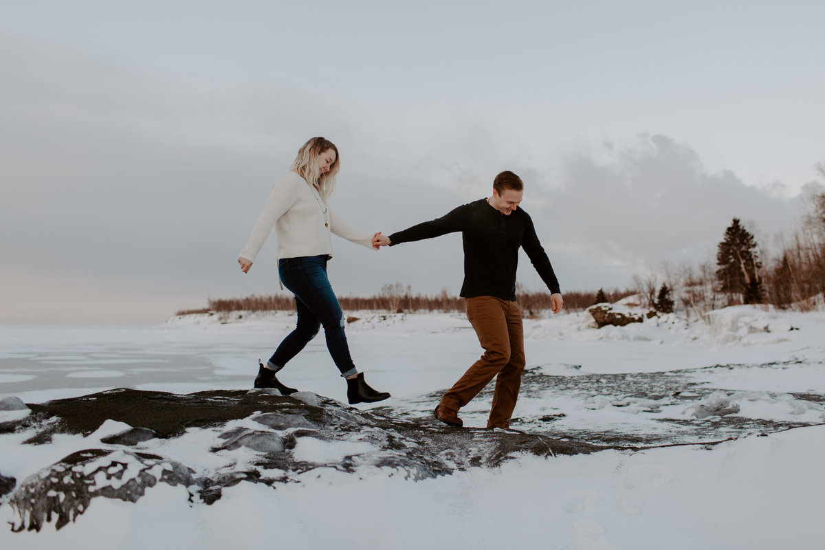 Winter Black Beach Minnesota engagement session by Skyler and Vhan