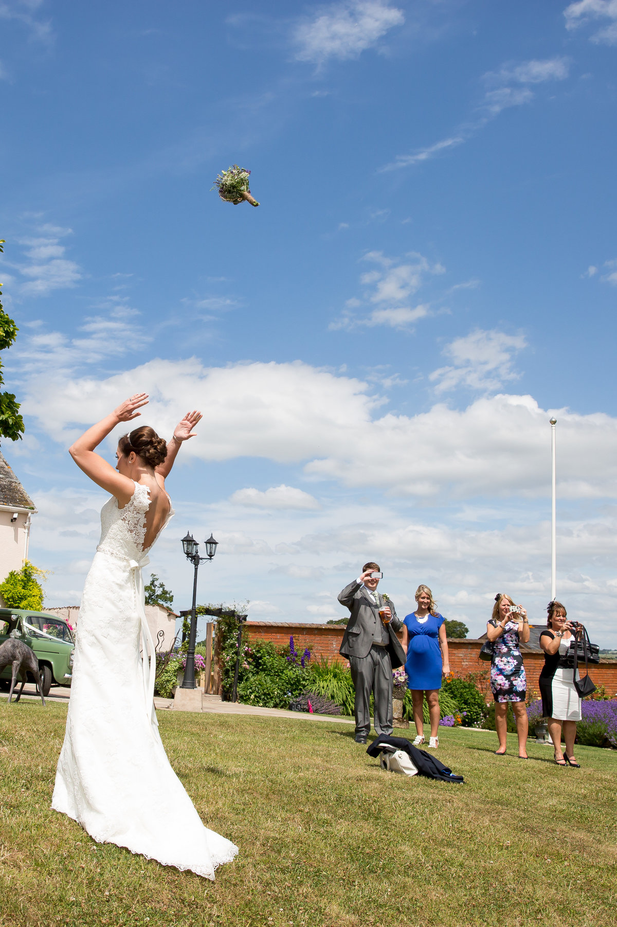 throwing brides bouquet at upton barn
