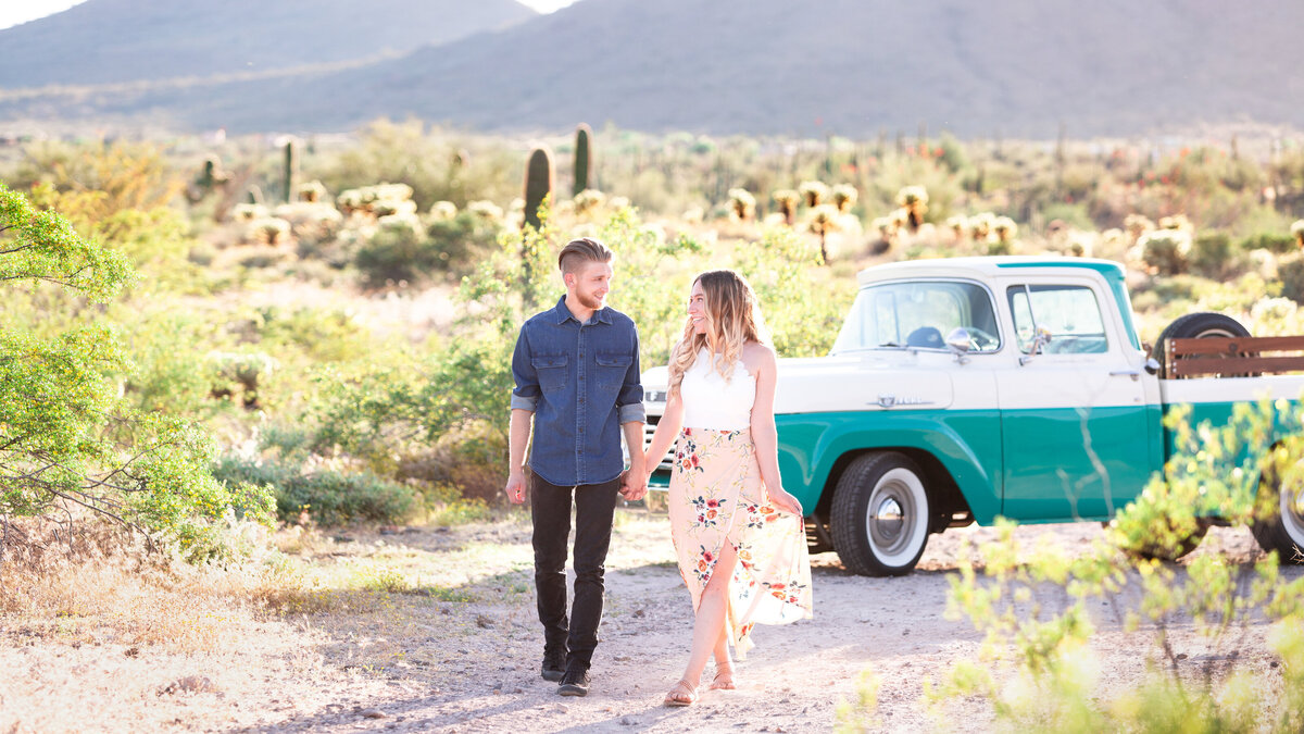 engaged couple with vintage truck
