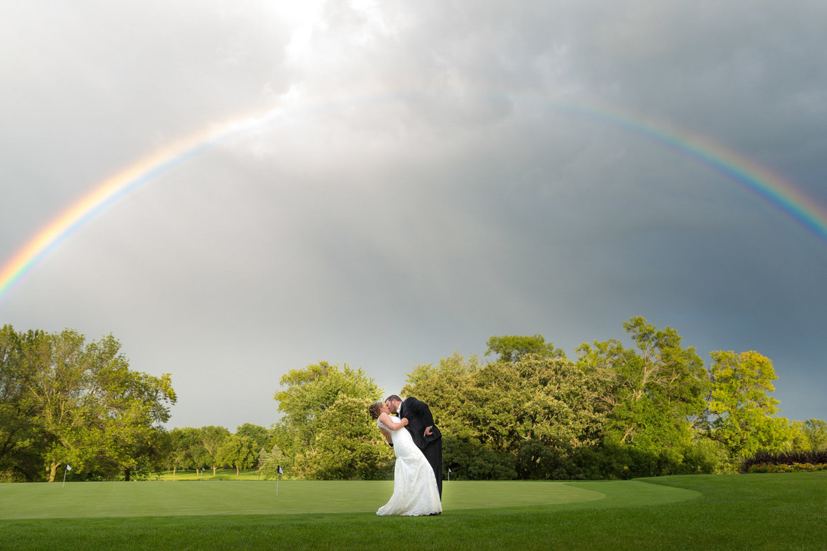 Rainbow on a wedding day during golden hour time