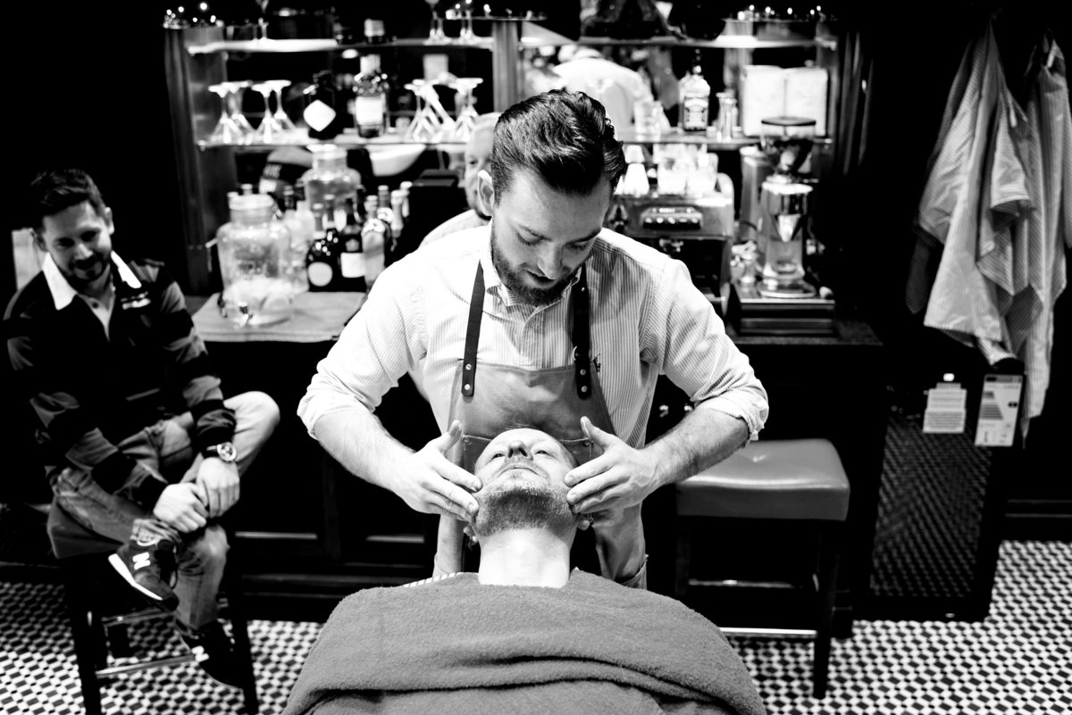 A Groom having a pre wedding shave during groom preparations in Chester