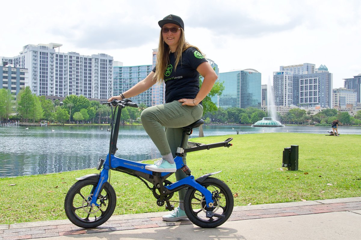 Go-Bike staff riding Blue Go-Bike M4 at Lake Eola Orlando