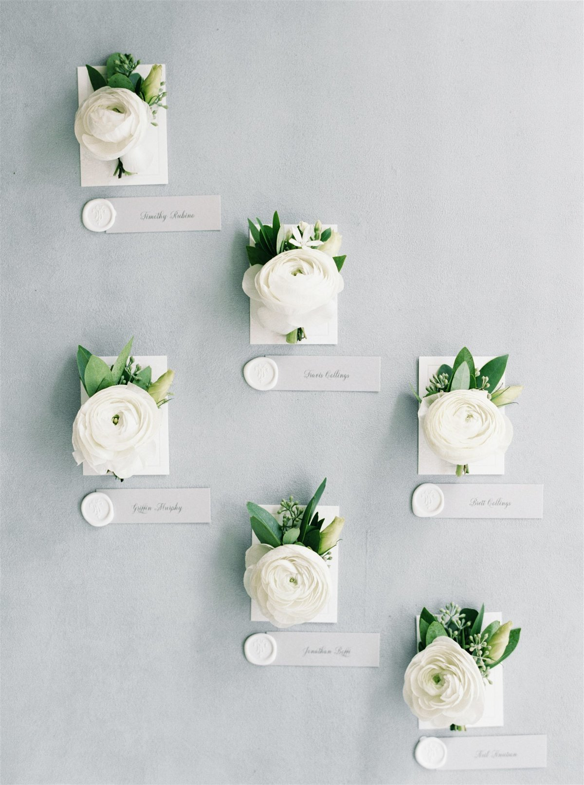 White ranunculus boutonnieres for groomsmenfor a Cape Cod Wedding by luxury Cape Cod wedding planner and designer Always Yours Events