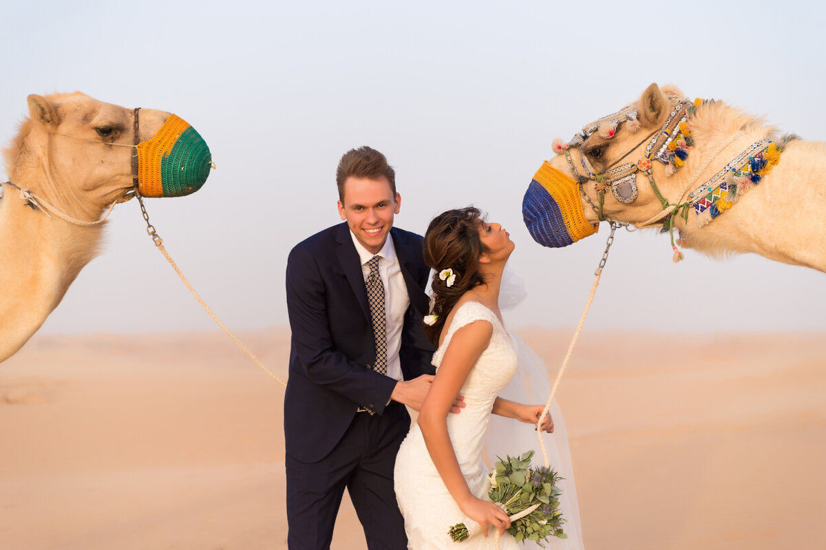 Wedding couple with two camels for a photoshoot in Dubai  organized by Lovely & Planned