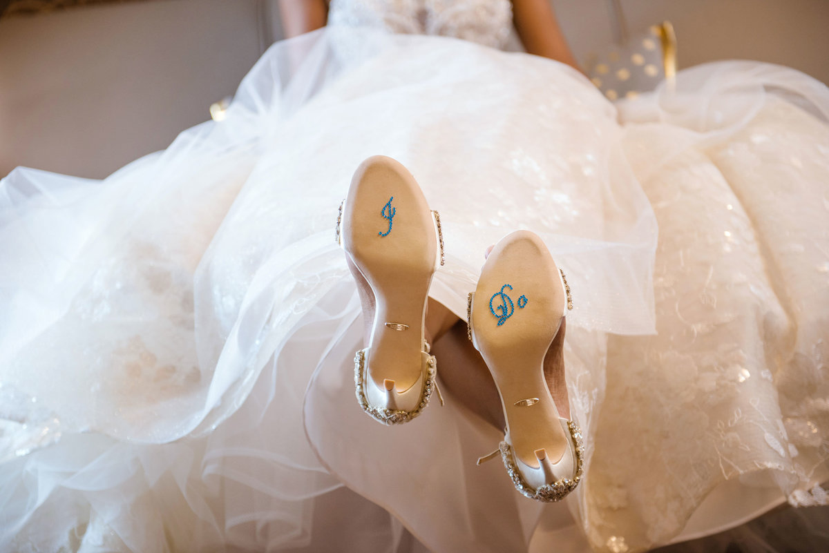 "Bride in dress with ""I Do"" on bottom of shoes The Inn at Fox Hollow"