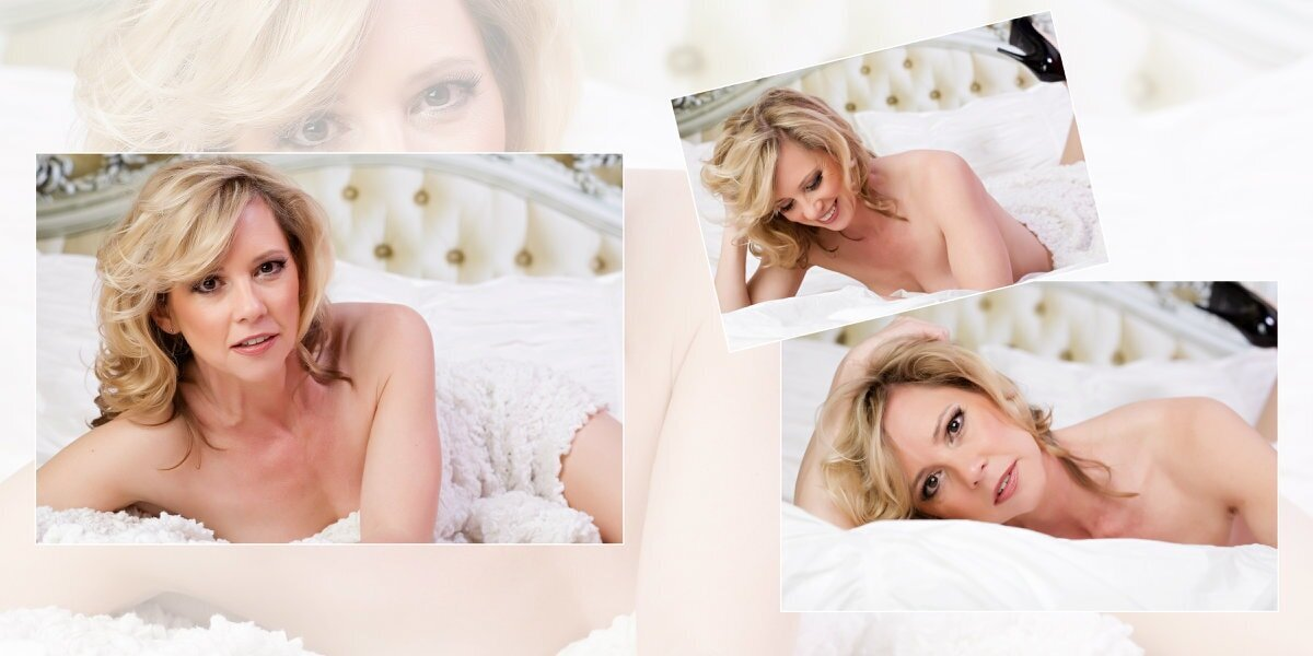 blonde woman posing for a boudoir portrait on a bed wrapped in a white sheet