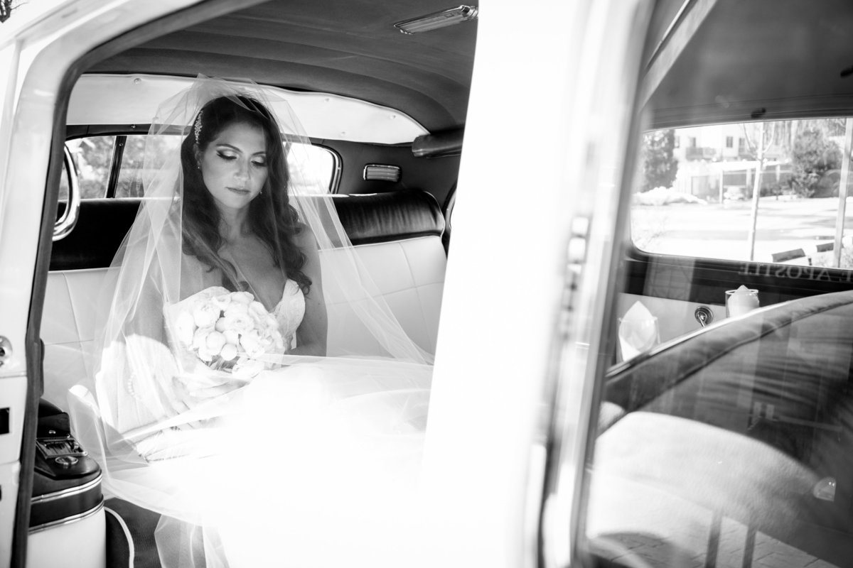 bride in rolls royce before wedding ceremony
