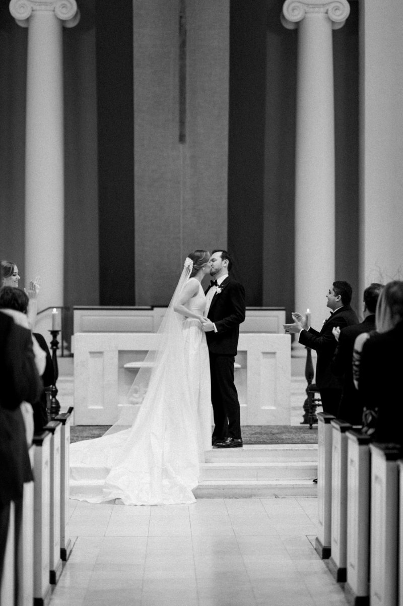 first-kiss-bride-groom-holy-trinity-catholic-church-dc