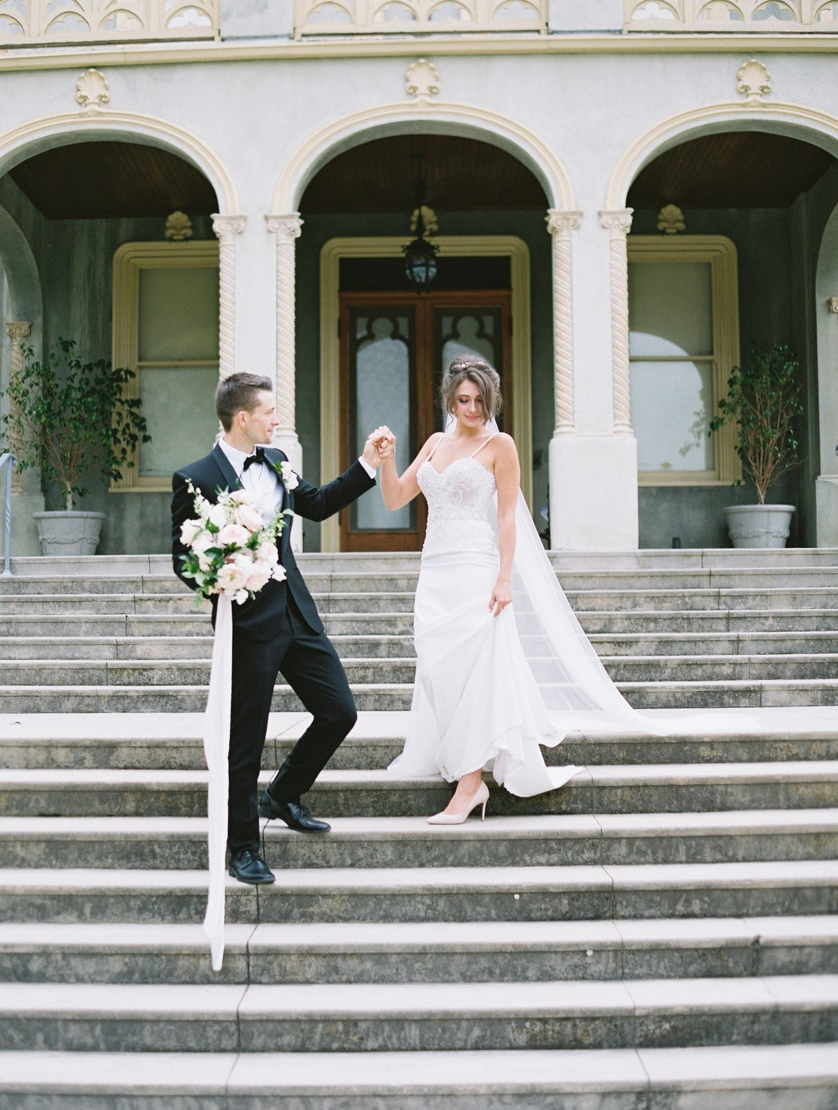 daniel-and-bethany-weddings-walking-down-stairs