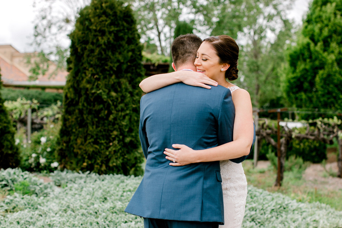 Bride and groom share embrace during first look at Vintners Inn in Santa Rosa California
