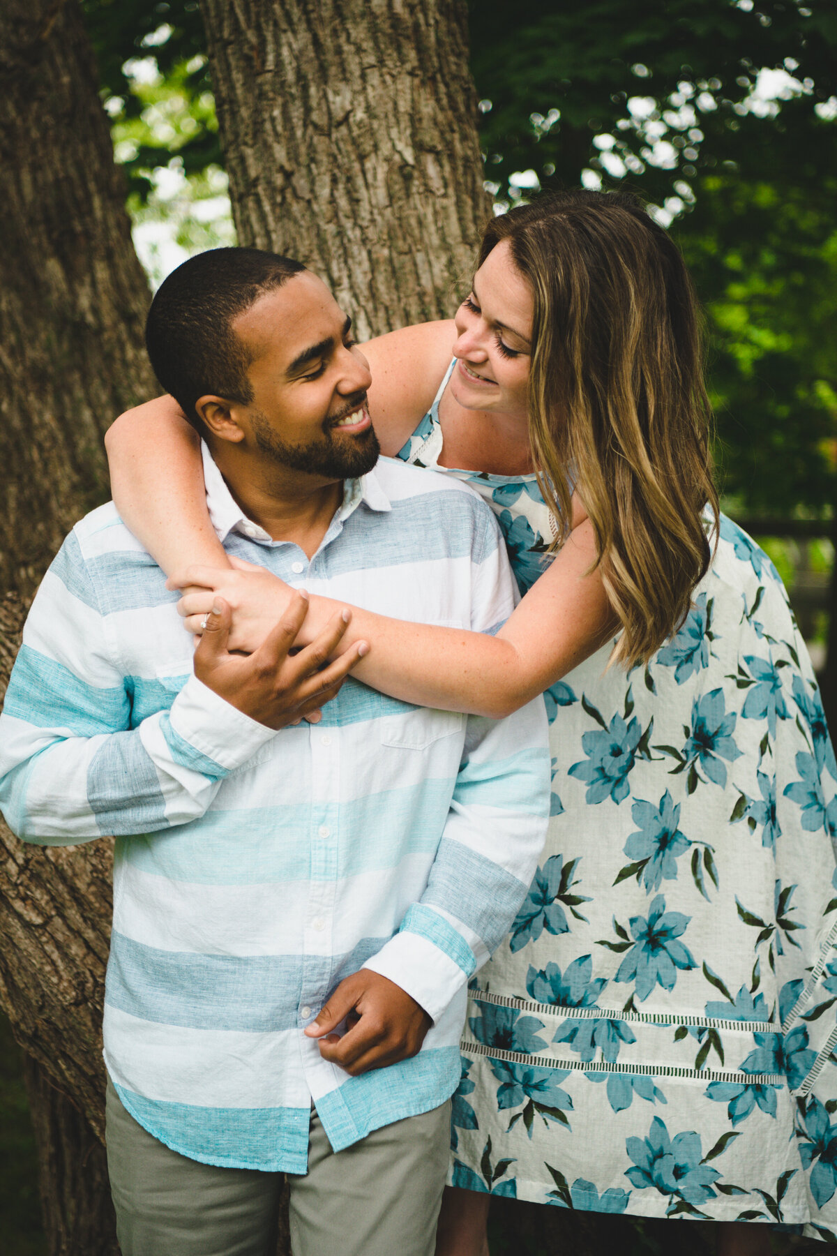 NH engagement photographer with couple hugging