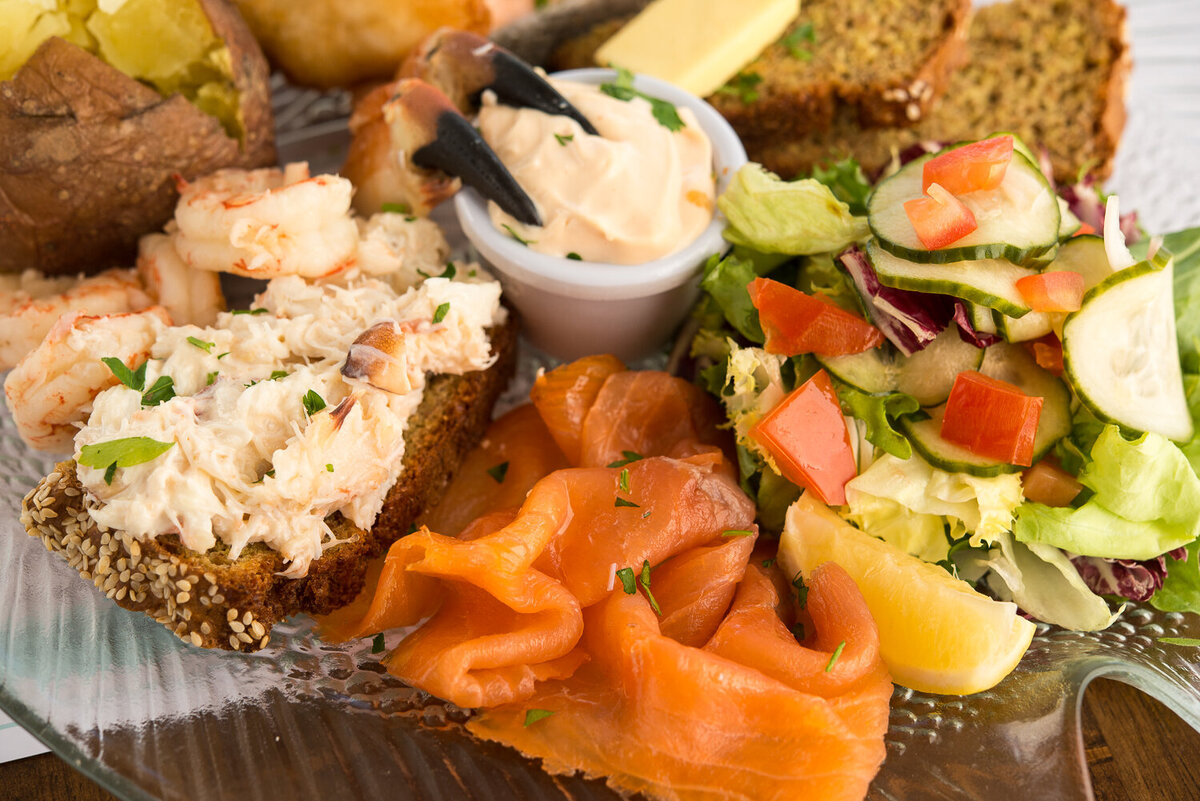 Crab, salmon, crab claws on seafood platter