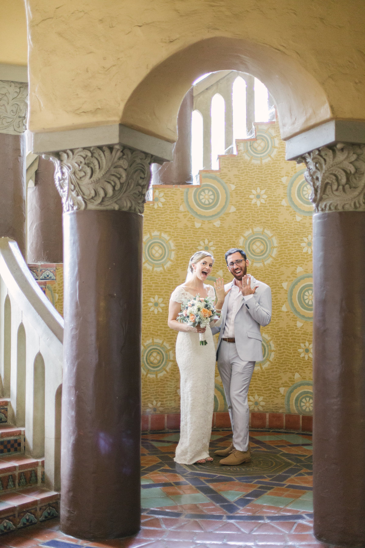 Bride and groom show off their rings after Santa Barbara Courthouse Wedding