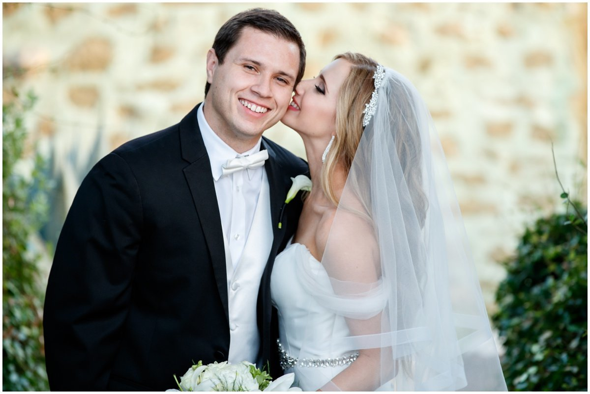 austin wedding photographer vintage villas bride kissing groom 4209 Eck Ln, Austin, TX 78734