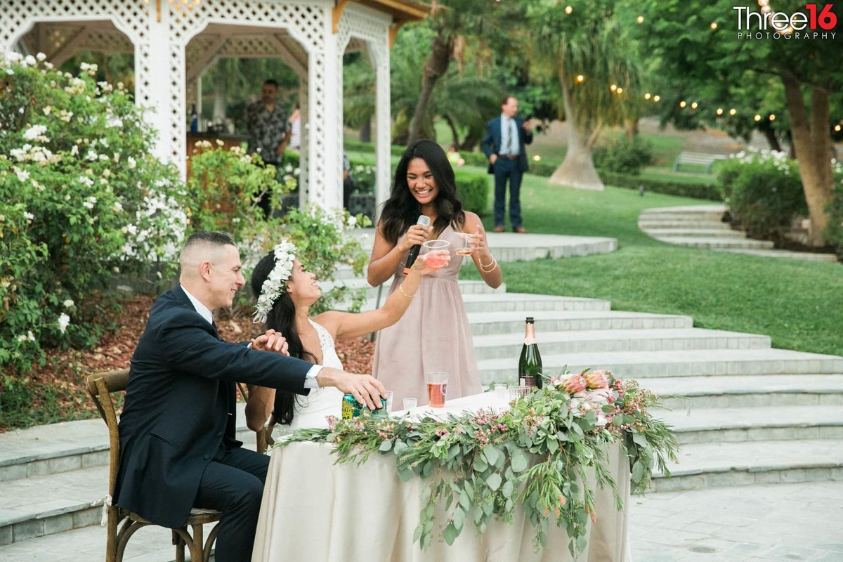 Newhall Mansion Piru California Los Angeles  Photographer Wedding Venue Bride and Groom toast