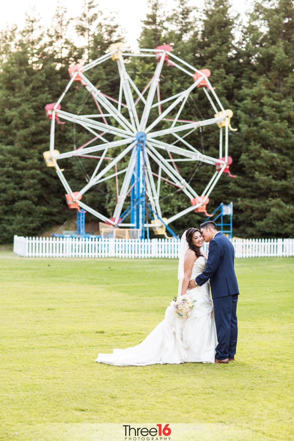 Intimate moment between Bride and Groom in front of the Calamigos Ranch Ferris Wheel