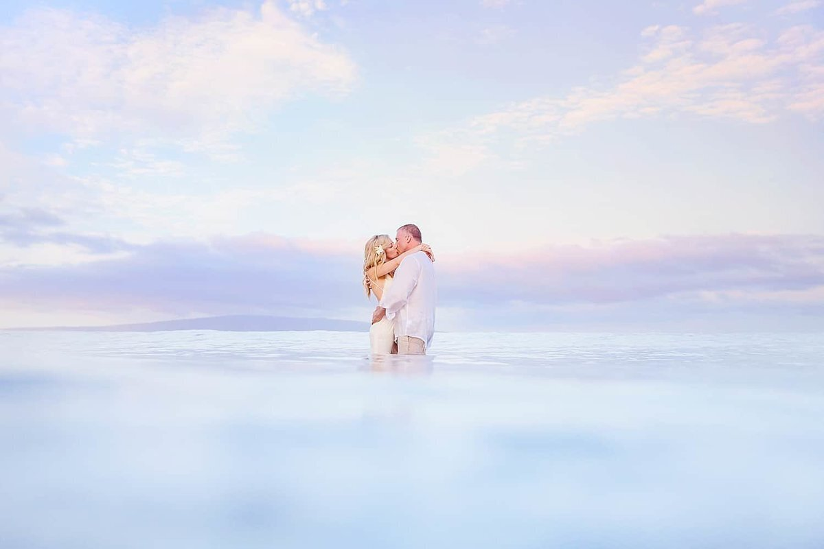 Maui sunrise elopement couple kissing in the ocean