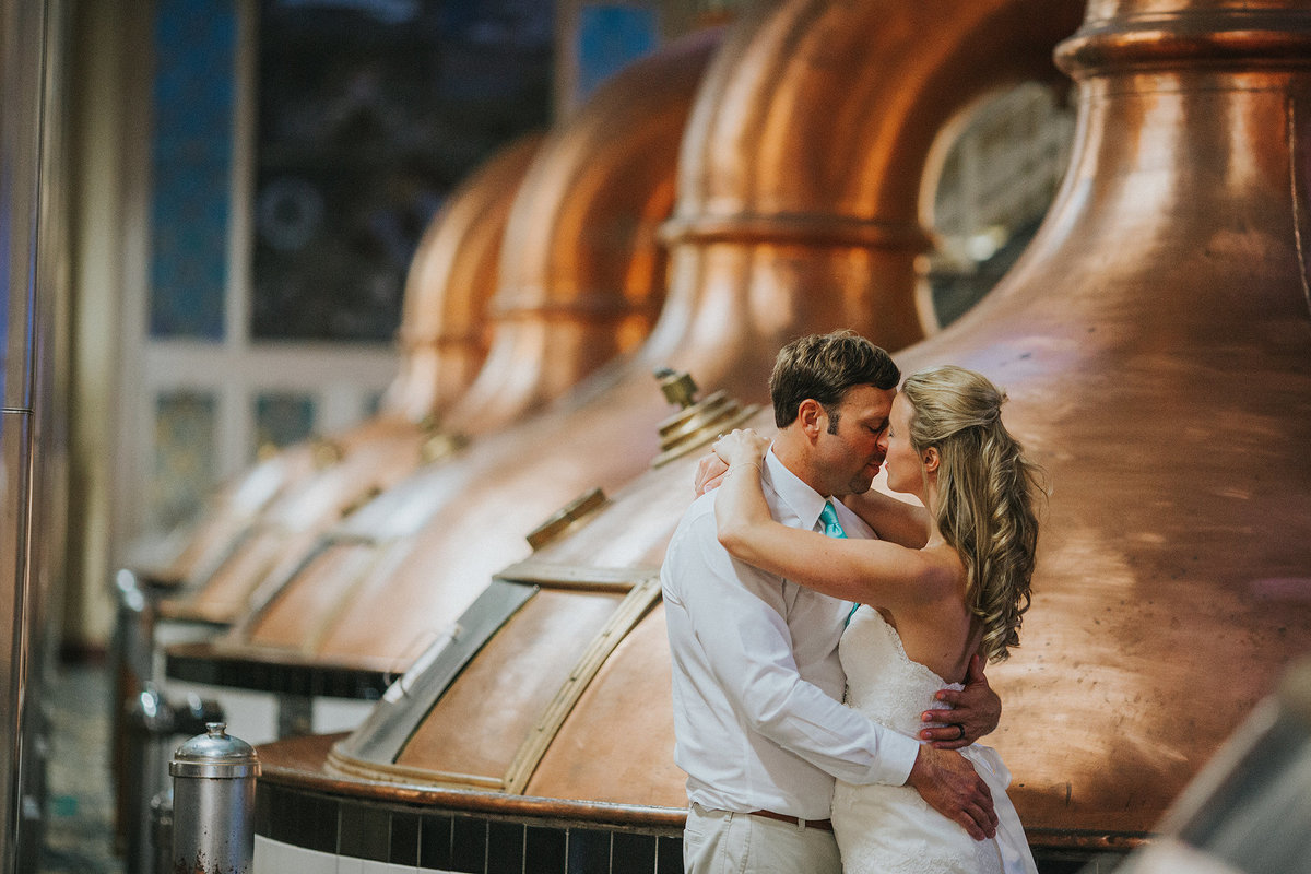 bride and groom hugging at pabst  company in milwaukee wisconsin