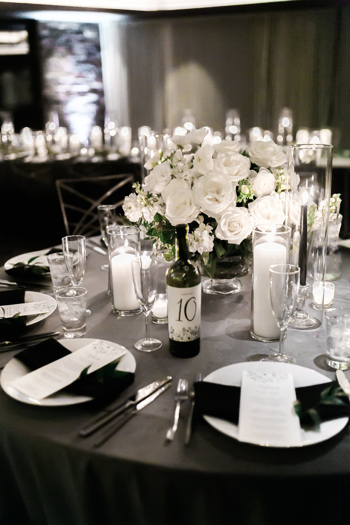 grey velvet linen with white floral centerpiece and black taper candles