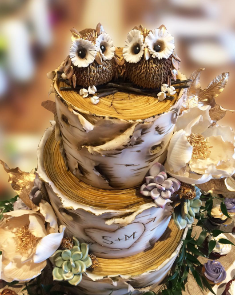 Whippt Desserts custom wedding cake with sculpted fondant owl topper