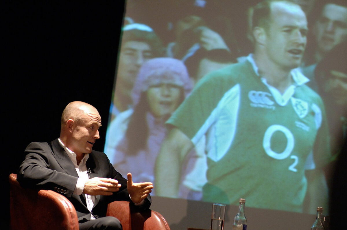 Rugby player speaking at conference