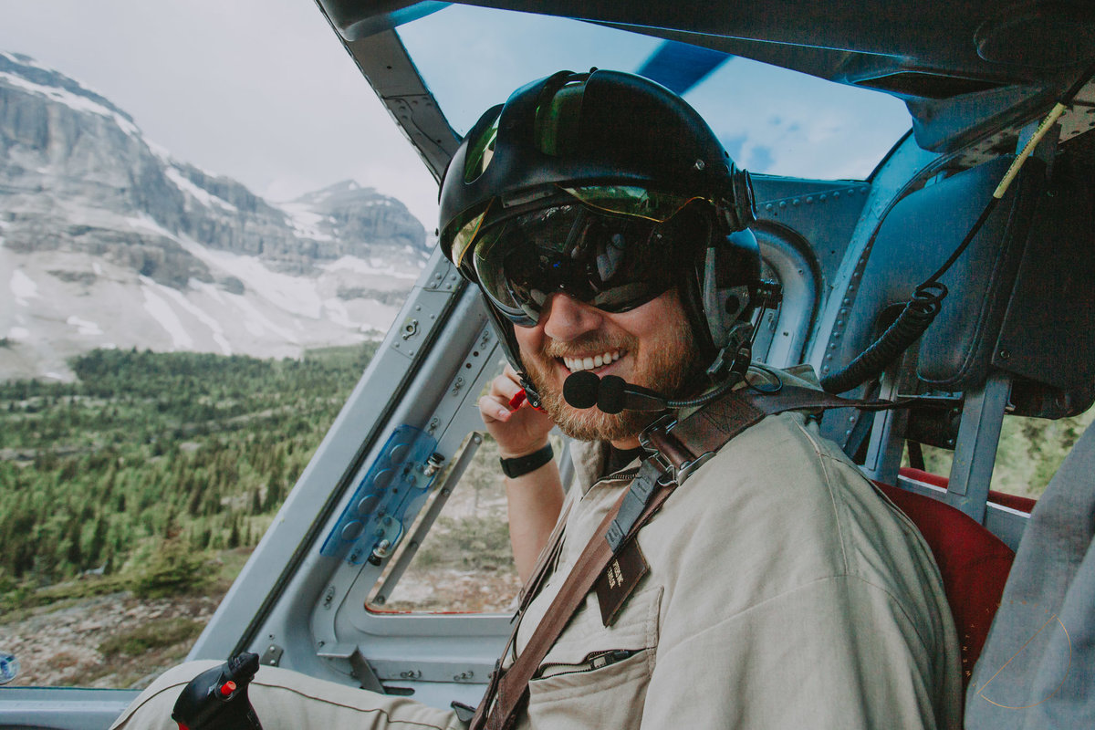 portrait of pilot from Alpine Helicopters in Canmore, AB during an adventure heli engagement session to Marvel Pass captured by 2020Photography