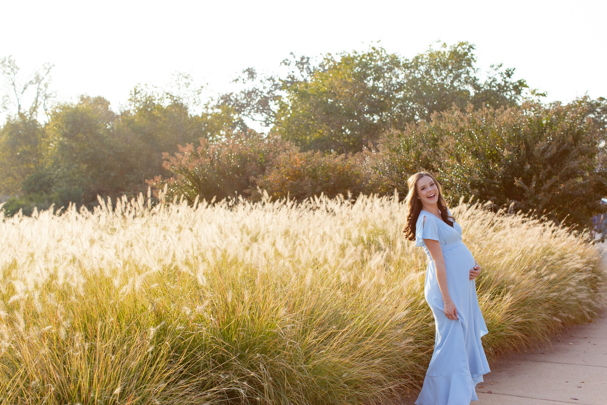Fall Sunset Maternity Session with blue maxi dress with tall grass at Pagoda Circle in Forest Park in St. Louis by Amy Britton Photography Photographer  in St. Louis