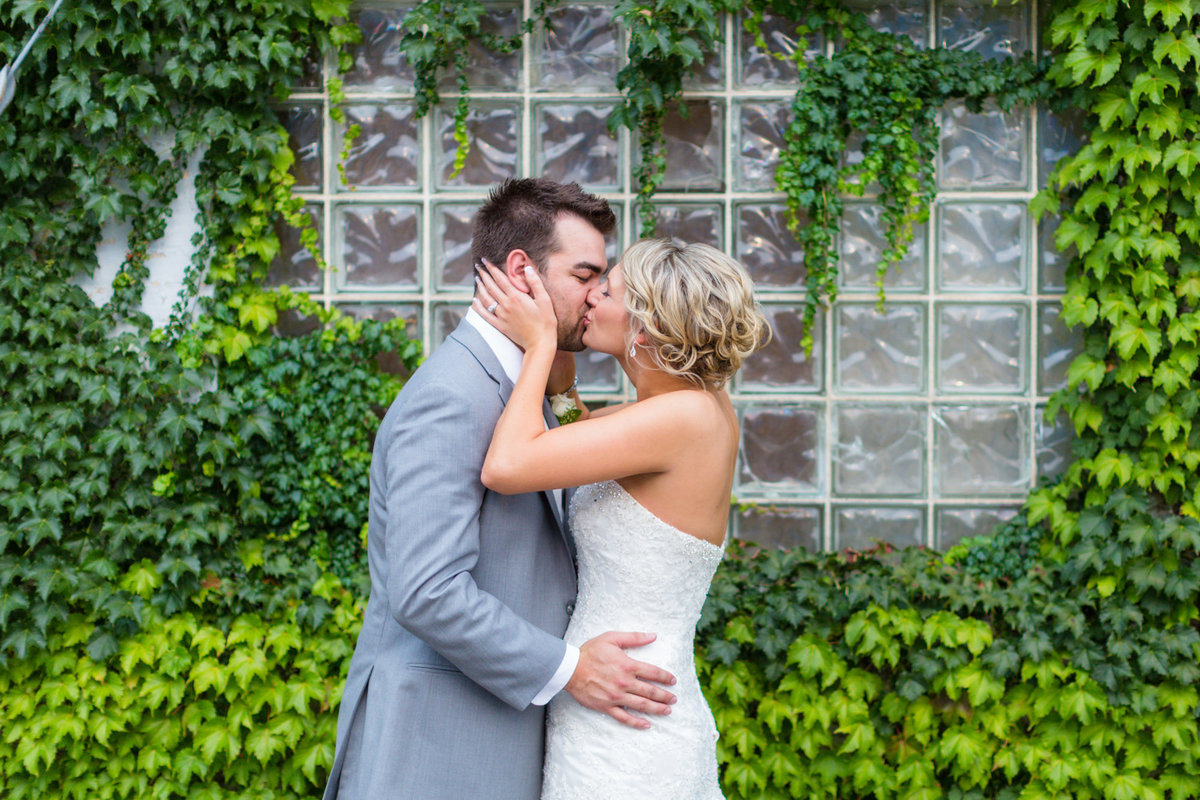 Bride & Groom with ivy on their wedding day in Rochester minnesota