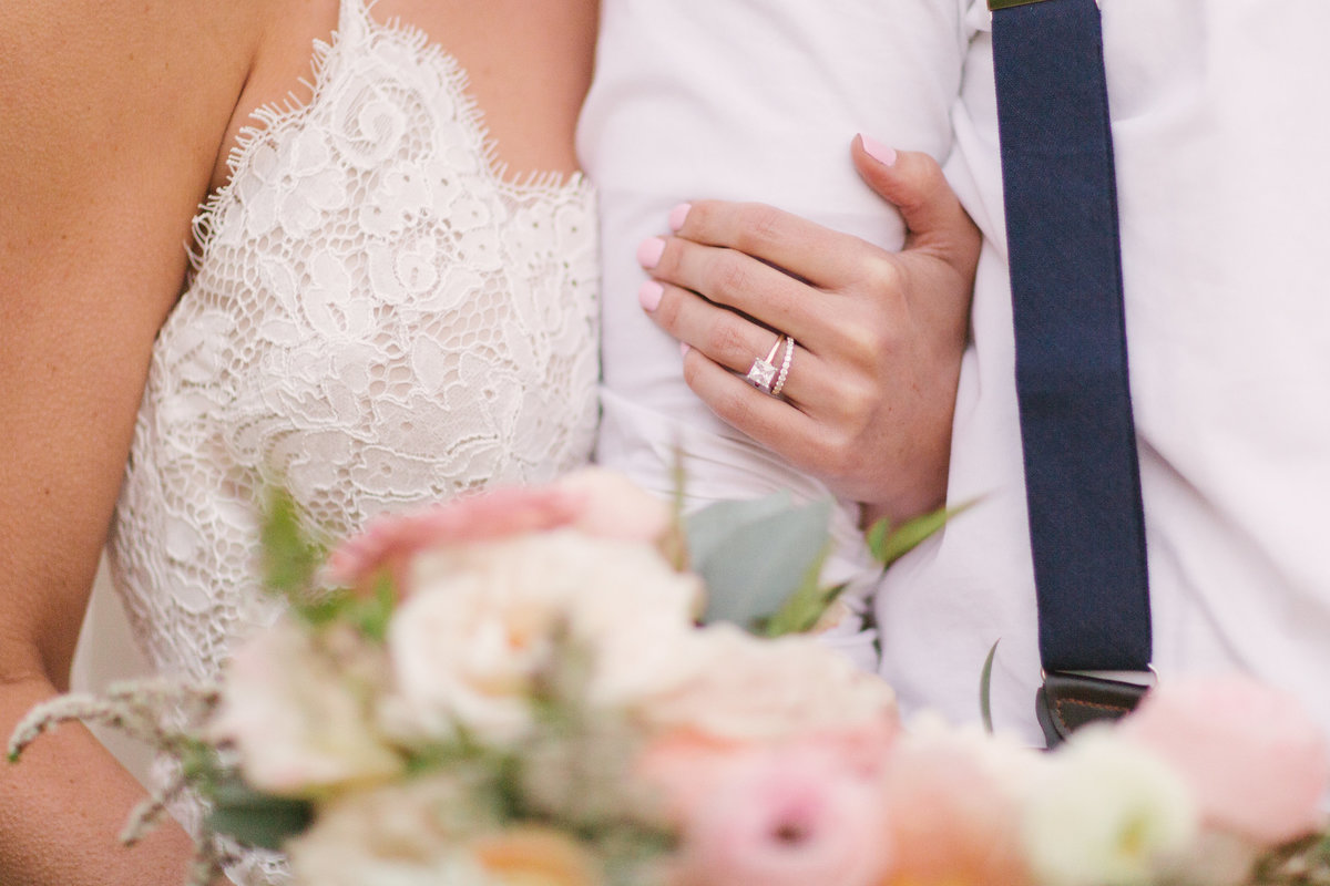 Bride holds onto grooms arm after Firestone Vineyard wedding